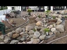 kräuterspirale mit wasserlauf die 25 besten ideen zu bachlauf bauen auf bachlauf im garten bachlauf und