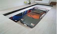 Car Elevator Garage by Toyko House Features Car Elevator In The Living Room