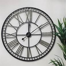 distressed oversized vintage black gold skeleton clock