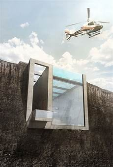 an innovative house carved out of a an innovative house carved out of a cliff