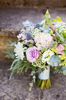 pretty pale blue fresh summer wedding flowers summer
