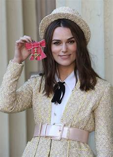 keira knightley receives obe from prince charles people com