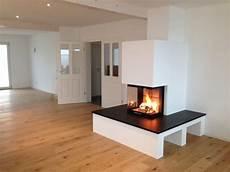 moderner 3 seitiger heizkamin mit naturstein fireplace