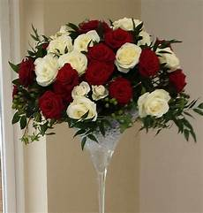martini glass decorated with red and white roses table