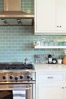 Blue Glass Tile Kitchen Backsplash This Is It White Cabinets White Counters Open Shelves
