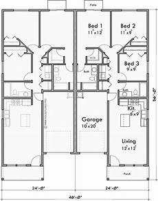 duplex house plans with garage duplex house plan with garage in middle 3 bedrooms