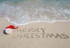 merry christmas in the sand photo images merry christmas merry christmas written tropical white sand with s
