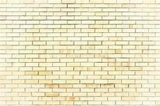 light yellow brick wall texture stone background of light yellow brick wall texture wall surface with light bricks