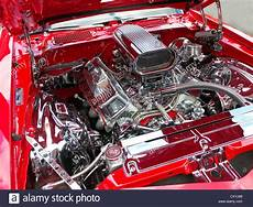 chromed v8 engine of an american luxury sports car stock