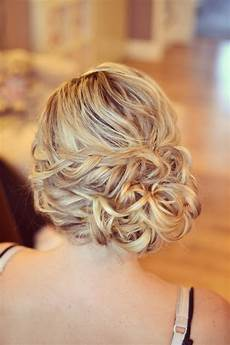 wedding hair side bun curls plaits bridesmaid guest by facebook com essexweddingbeauty