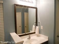 framing the bathroom mirrors