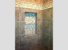 Shower niche, shampoo box, and master bathroom tile by