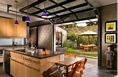 Kitchen Door To Garage by Sectional Glass Garage Doors Used In Modern Designs