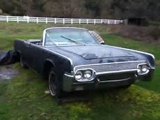 two 1961 lincoln continental convertible top