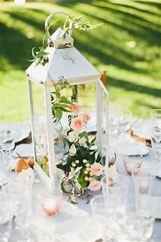 composizioni con candele e fiori lanterns and pears wedding centerpieces wedding