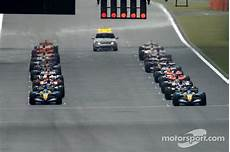 Starting Grid Waits For Green Light At Gp
