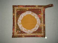 akasia home deco pot holder with paper piecing design