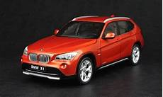 bmw x1 1 43 kyosho 1 18 bmw x1 orange diecast car model