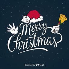 merry christmas lettering with santa hat vector free download