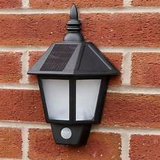 black outdoor solar security welcome wall light with pir best solar garden lights manufacturer