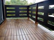 lay patio and balcony with wooden tiles use wood tiles