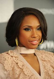 romantic bobby pinned updo for african american women