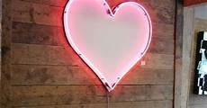 heart shaped mirror lit in neon pink lighting light strands wall decor other non l