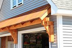 timber frame eyebrow roof over garage doors rustic metal roofing home building plans 11371