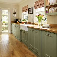 step inside this traditional muted green kitchen ideal home