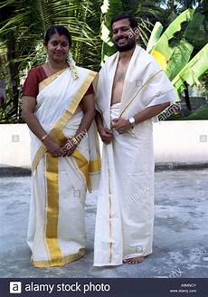 traditional costumes of kerala for a couple in traditional kerala dress stock photo royalty