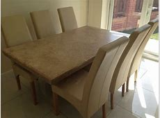 Barker and Stonehouse Marble stone dining table and 6