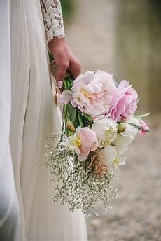 picture of the bridal bouquet was a diy one with blush and ivory blooms and baby s breath