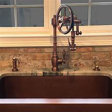 copper kitchen sink faucets waterstone wheel faucet in antique copper goes great with the copper sink in 2019 copper