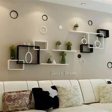 tv background wall shelving cross creative lattice shelf