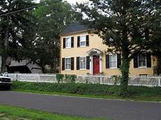 beautiful yellow house door black shutters and we have light yellow siding really want to