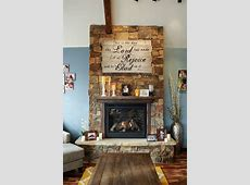 my rock fire place in living room.. dIY fire place sign