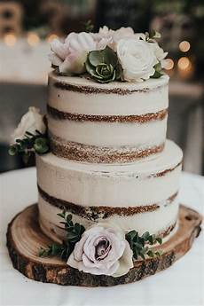 two tier rustic naked cake with fresh flowers brides