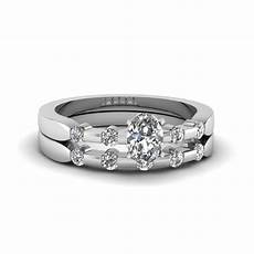 oval shaped delicate diamond wedding ring in 14k white