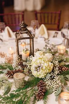 centerpiece with lantern pinecones and hydrangeas