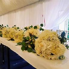 winter white wedding reception low centerpieces by buen gusto flowers at california flower