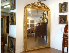 large mirror glass wood stucco golden flowers foliage