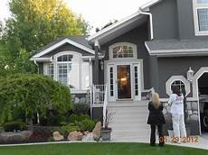 dark gray stucco home painted by certapro painters of