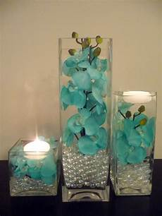 teal turquoise painted orchids in 3 pc vase and floating candlesvendors event