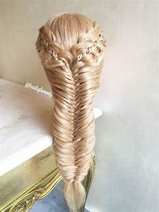 four strands with braids into mermaid fishtail braid