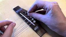 Pin On Guitars Changing Guitar Strings What Causes Flying Bridge Pins