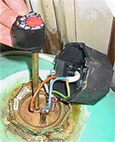 changing an immersion heater thermostat to avoid cold or scolding water