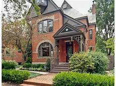 dormer color with darker trim painted brick exterior in