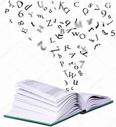 libro lettere d open book with letters falling into the pages stock