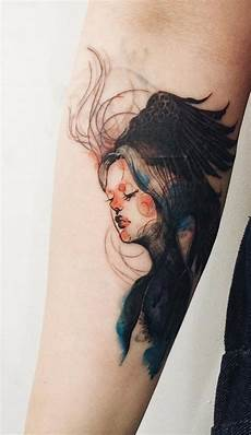 interesting designed abstract portrait on arm