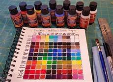 artist angela shows how to create a color mixing chart using decoar color mixing
